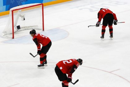 Canada mourns after coming up short in hockey, curling