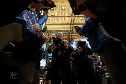 Wall Street advances as financial, energy stocks gain