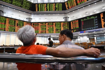 Asia stocks pull back after soft China data; oil higher