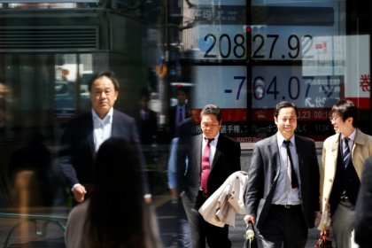 Asian shares stumble as dollar strengthens, oil surges