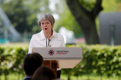 UK PM May joins families to remember Manchester pop concert victims