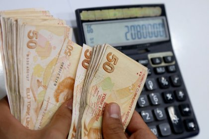 Turkish lira volatile, central bank moves to help firms on foreign debt