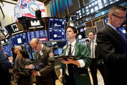 Wall St. slips on renewed trade-war worries but posts monthly gains