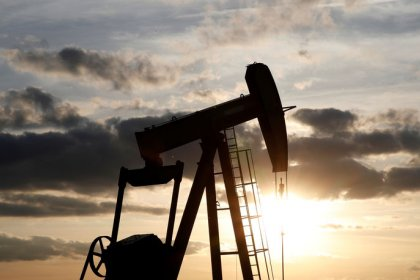 Oil edges up as U.S. crude stocks fall, Iran sanctions weigh