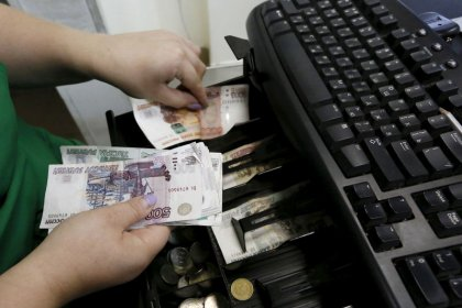 Ruble falls beyond 70 per dollar, central bank in focus