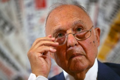 Italy's Savona seeks euro zone debt restructuring, backed by ECB