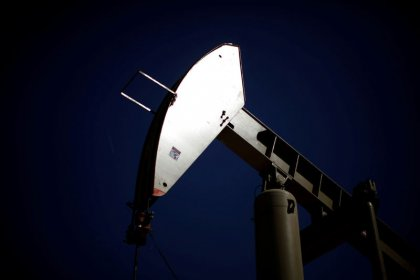 Oil eases, but Iran sanctions keep prices near late 2014 highs