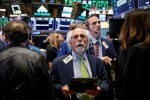 Intel helps Wall Street shrug off Italy woes, sends Dow to record
