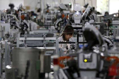 Japan manufacturers' mood rises, trade worries weigh on outlook:  Reuters Tankan