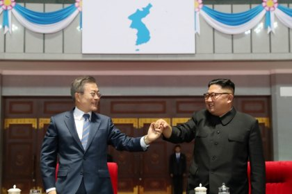 Koreas to reconnect roads, rail, U.S. concerned over easing sanctions