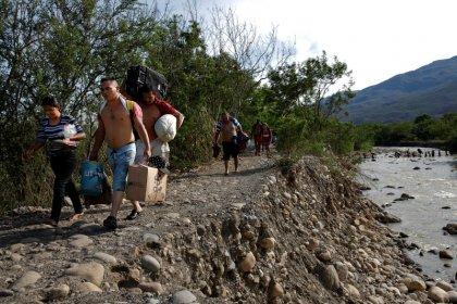 Fleeing hardship at home, Venezuelan migrants struggle abroad, too