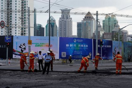 China to show off its zeal to import but business awaits policies