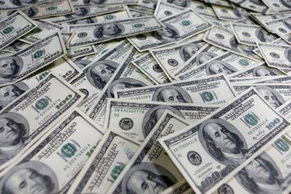Dollar rises on firmer U.S. yields; yuan struggles