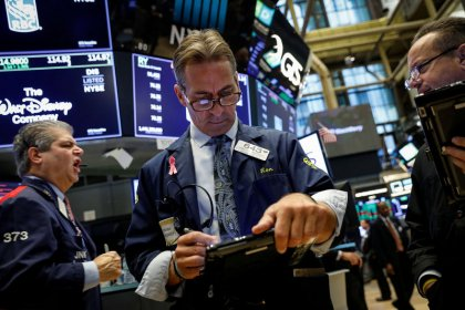 Wall St. rallies over 2 percent with earnings, data boost