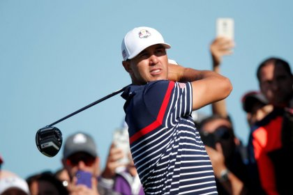 Golf - Koepka leads in Korea, closes in on No.1 ranking