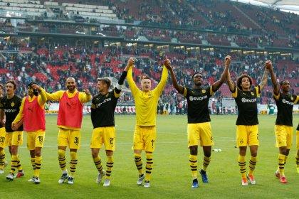 Dortmund crush lowly Stuttgart to stay top