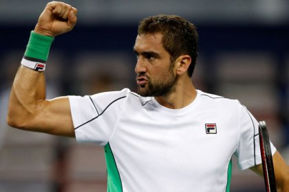 Cilic downs Shapovalov to reach second round in Basel