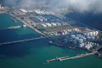 Oil edges back from big slump as Iran sanctions return to focus