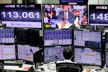 Equities fall after Fed keeps rates on hold, dollar up