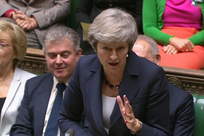 May tries to sell Brexit deal but opposition mounts
