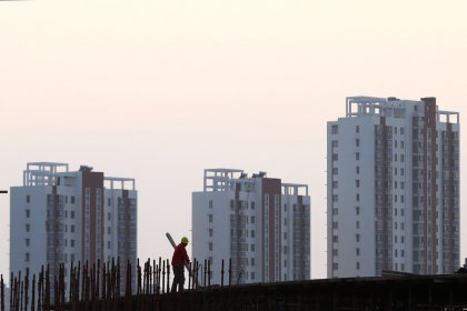 China's home prices gather pace but speed bumps seen ahead