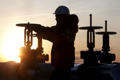 Oil prices stable on expected OPEC cuts, but surging U.S. supply drags