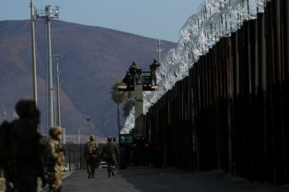 Captain says U.S. military does not view Central American migrants as 'enemies'