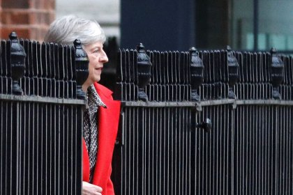 May defends Brexit deal as opponents plot no-confidence vote