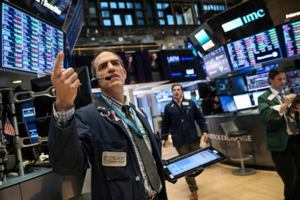 Wall Street hit by Apple and internet shares, trade worries