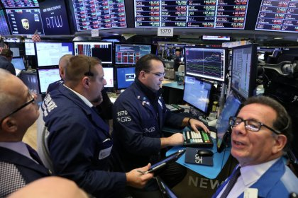 Retail warnings, tech tumble hit Wall Street