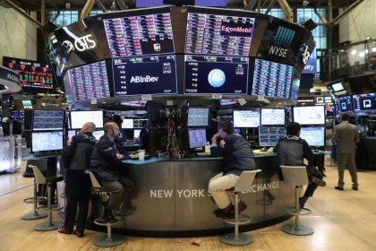 Wall St. rebounds on robust jobs report, dovish Powell remarks