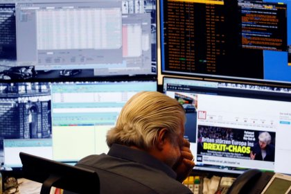 World stocks ride out May's Brexit defeat, pound steadies