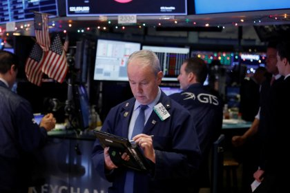 World stocks rise; sterling up ahead of May vote