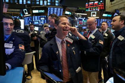 Health, defense stocks help Wall Street grind higher