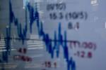 Asian shares, U.S. stock futures slip as growth worries loom