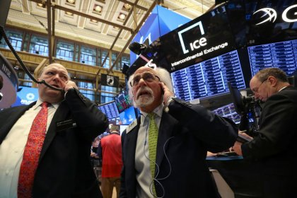Wall Street ends higher, helped by earnings