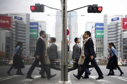 Japan's GDP rebounds from quake, floods but trade war hangs over 2019