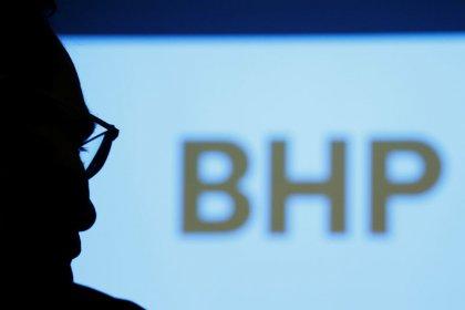 Global miner BHP Group reports first-half profit fell 8 percent