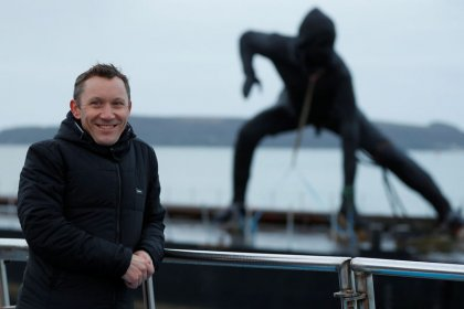 Britain's biggest bronze statue crosses land and sea to reach new home