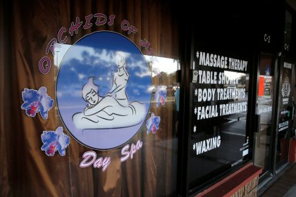 Democrats target massage parlor proprietor linked to Trump