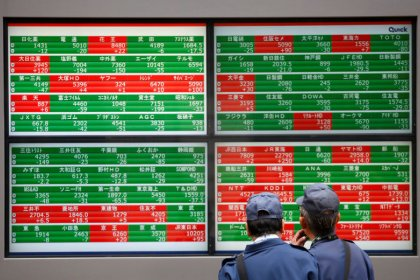 Asian shares flat as Fed looms, May's Brexit deal in chaos