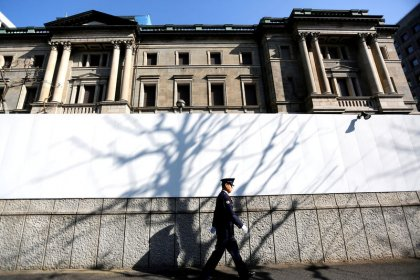 Japan bank executive says mergers won't fix woes brought by BOJ policy