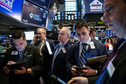 Wall St. edges higher as tech boost counters losses in bank stocks