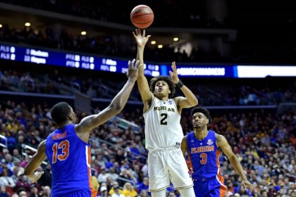 Poole, Michigan dispatch Florida with strong second half