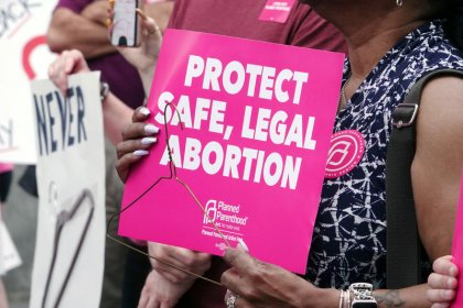 Hundreds rally at U.S. Supreme Court, calling state abortion bans as step backward