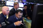 Stocks rise on earnings; sterling falls