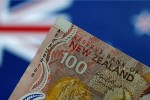 Aussie, New Zealand dollars seen defying gravity, even as gravity wins out: Reuters poll