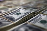 Dólar cai ante real após BC mudar forma de atuar no câmbio, mas exterior limita melhora