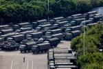 China warns it could quell Hong Kong protesters; Trump urges Xi to meet them