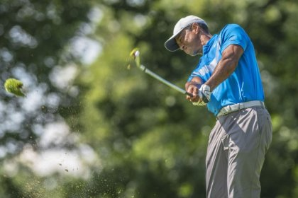 Tiger's charge fizzles in second 71 at BMW